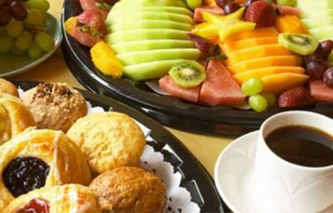 "Assorted fresh Danish, donuts, muffins & ""Country Bagel"" bagels served with cream cheese, butter & jelly and a fresh fruit tray"