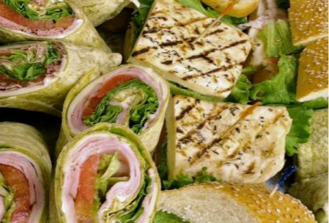 An assortment of oven roasted turkey breast, tavern ham, Italian meats, freshly roasted top round of beef, tuna salad & vegetarian veggie on homemade grilled focaccia bread, baguettes, wraps & croissants. All sandwiches are made with provolone cheese, lettuce & tomatoes and are served with roasted peppers, roasted jalapenos & dijonaise on the side.