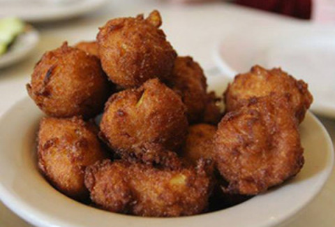 Sweet and savory corn puffs served with a remoulade sauce.