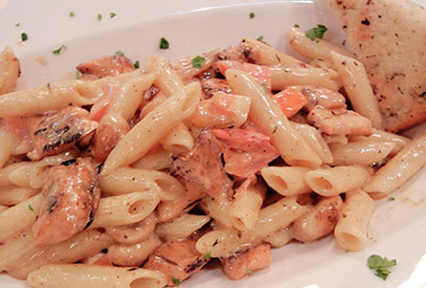 Fresh Atlantic salmon, blackened in our secret seasoning, pan seared and served over our Creole tomato sauce with penne.