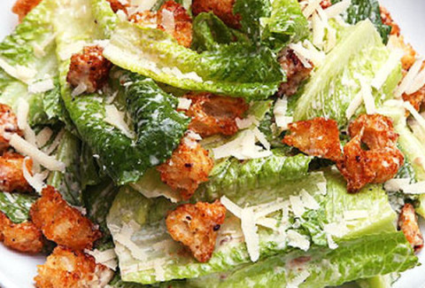 Romaine & green leaf lettuces freshly tossed with parm cheese & croutons and our own secret recipe Caesar dressing. Add grilled chicken for $1 more per person.