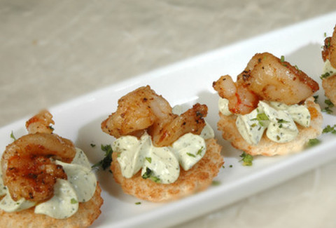 Pan seared shrimp and sweet mustard cream spread served on a cracker.