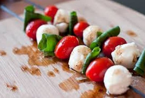 Fresh mozzarella balls, grape tomatoes and fresh basil served on a bamboo skewer and drizzled with a balsamic reduction.