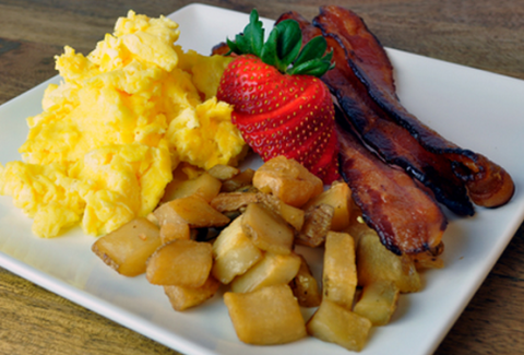 Eggs scrambled with Colby jack cheese and served with seasoned breakfast potatoes, bacon & sausage.