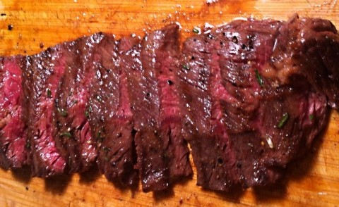 Marinated hangar steaks, grilled & served medium rare in red wine sauce topped with blue cheese.