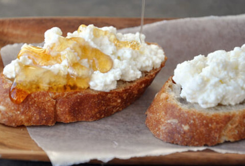 A French baguette crostini topped with goat cheese and pine nuts. Toasted and drizzled with honey.