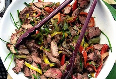 Tender strips of marinated and grilled London broil served over our Jade Rice & Grapes Salad.