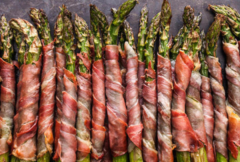 Prosciutto wrapped asparagus spears with herbed cream