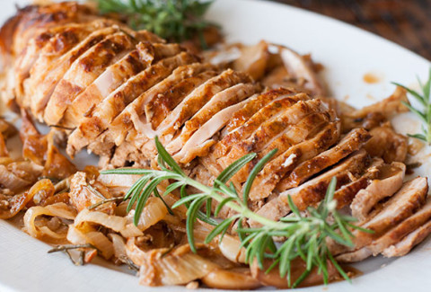 Herb & olive oil coated turkey breasts, slow roasted, sliced and served in our homemade turkey gravy.