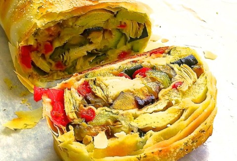 A mixture of roasted zucchini, squash, bell peppers, carrots & onions, wrapped in phyllo dough and baked until golden brown.