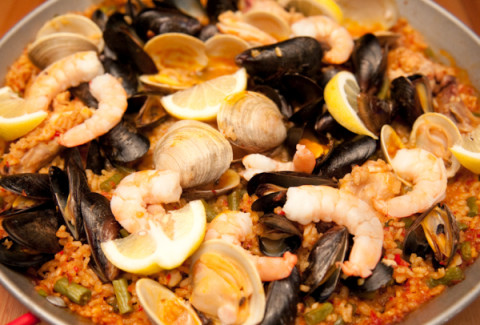 A classic Mediterranean rice dish (mildly spicy), made with clams, shrimp, scallops, chicken & saffron.