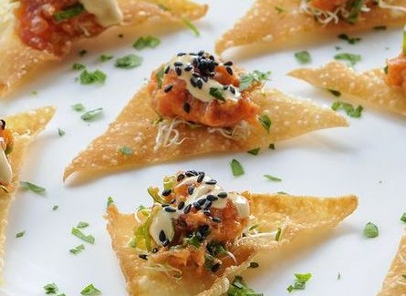 #1 Ahi Tuna tartar mixed with spicy mayo, served in freshly made fried won ton cups and topped with diced scallions.