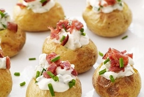 Roasted baby red bliss potatoes stuffed with cheese, bacon & sour cream and baked.