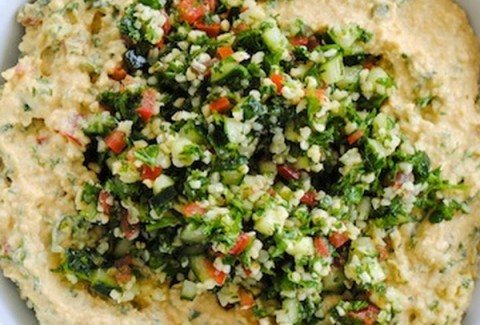 Traditional cracked wheat salad served with chickpea hummus and curried pita chips.