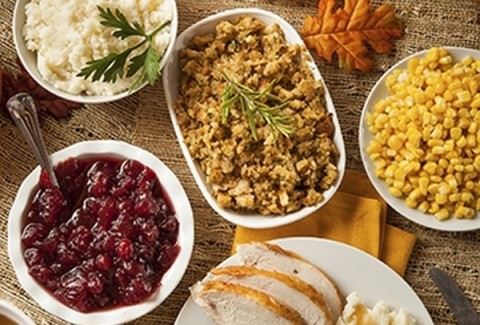 Traditional thanksgiving dinner with all the fixins! Our roasted turkey, stuffing, corn, gravy & homemade cranberry sauce.